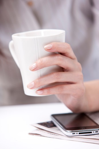Close-up of human's hand holding a cup : Stock Photo