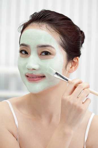 Stock Photo: 1397R-69513 Beauty Treatment, Woman applying facial mask on face with a make-up brush