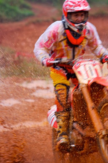 Young man motocross over field. : Stock Photo