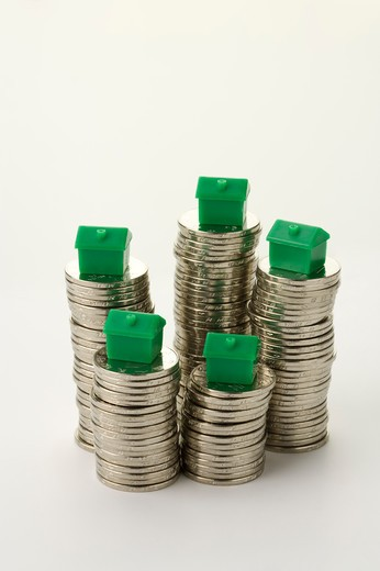 Stock Photo: 1397R-69628 China Currency, model houses placed on top of stacks of coins