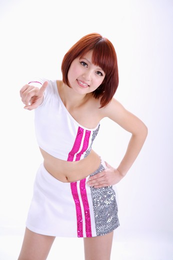 Stock Photo: 1397R-69847 Young woman looking at the camera and making gesture of touching