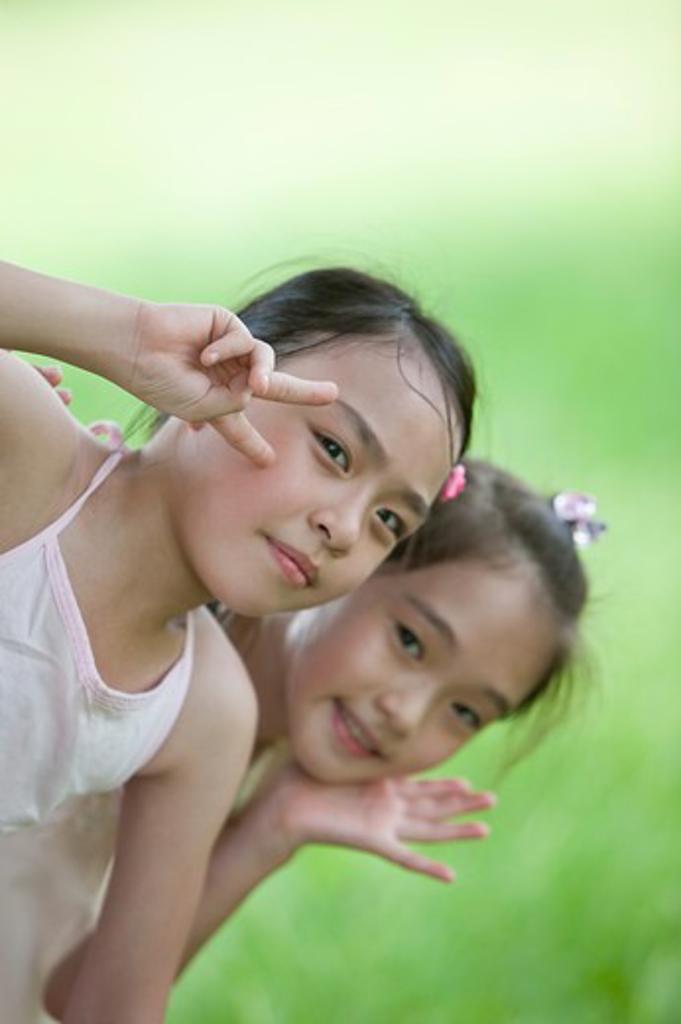 Girls smiling at camera, gesturing : Stock Photo