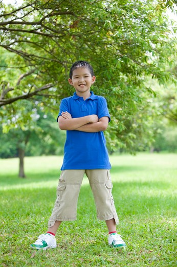 Boy standing in a park : Stock Photo