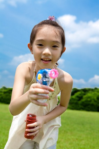 Stock Photo: 1397R-71112 Girl showing toy