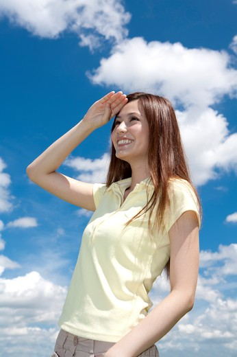 Young woman looking away with smile : Stock Photo