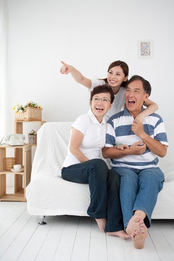 Stock Photo: 1397R-71320 Family with one child looking away and smiling happily together