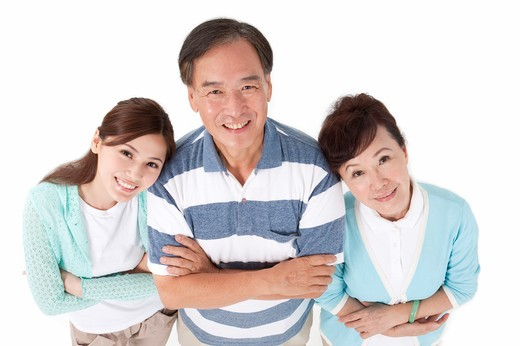 Parents with daughter looking at the camera and smiling together : Stock Photo