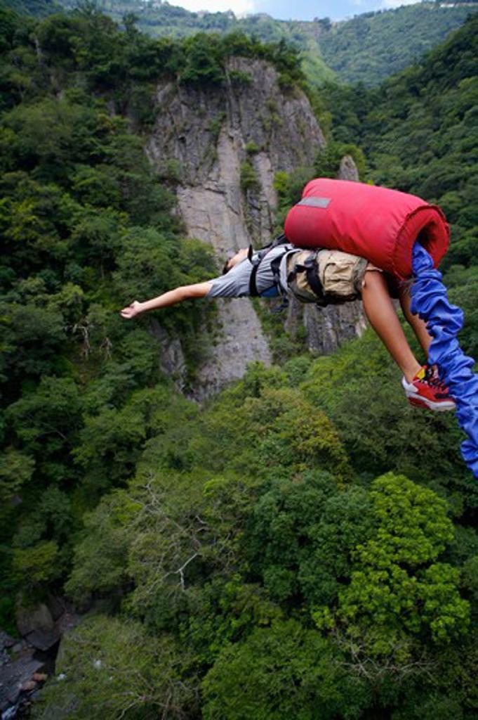 Male bungee jumper falling backwards : Stock Photo
