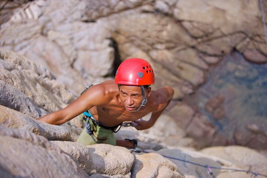 Stock Photo: 1397R-71605 Man rock climbing on cliffs, high angle view
