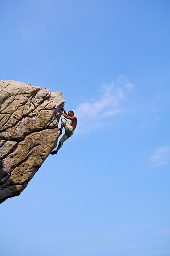 Stock Photo: 1397R-71703 Mature man climbing on the cliff, Rock Climbing, Extreme Sports