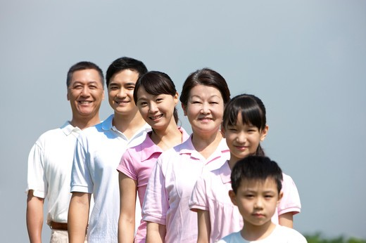 Stock Photo: 1397R-71748 Multi-generational family standing in a line, smiling