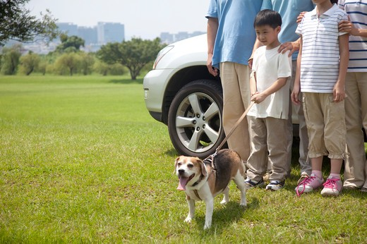 Stock Photo: 1397R-71798 Family outing with their dog