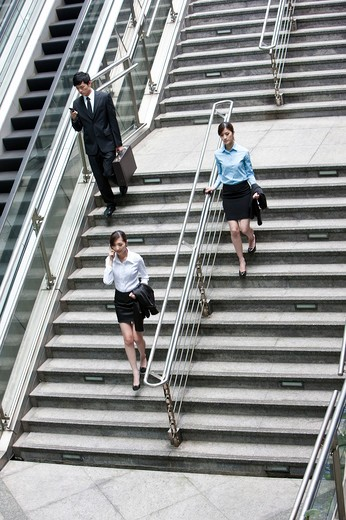 Stock Photo: 1397R-72185 Business people walking down the stairs, elevated view