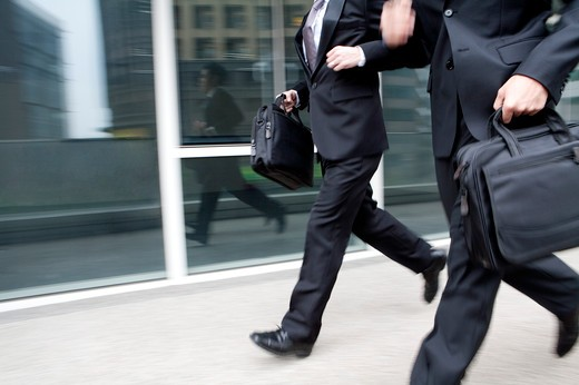 Stock Photo: 1397R-72245 Businessmen running in a hurry, blurred motion