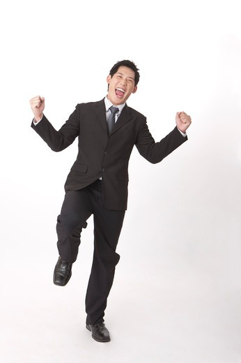 Stock Photo: 1397R-72272 Businessman laughing with fists up