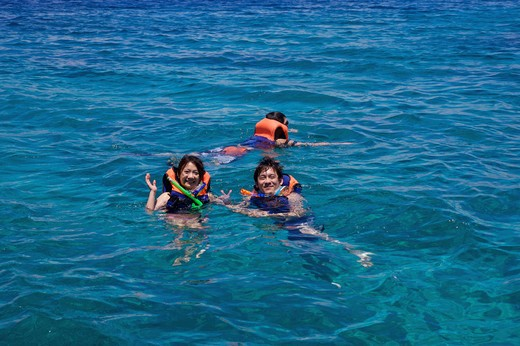 Caogahan Island, Cebu, Philippines, Asia, Three people scuba diving together : Stock Photo