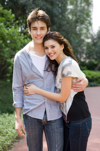 Stock Photo: 1397R-75330 Embracing young couple