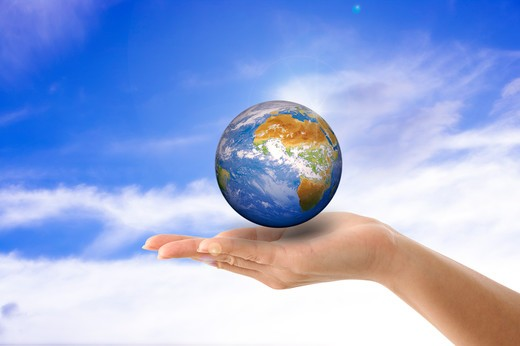 Stock Photo: 1397R-75768 Environmental Conservation, Digitally generated image of human hand holding the earth