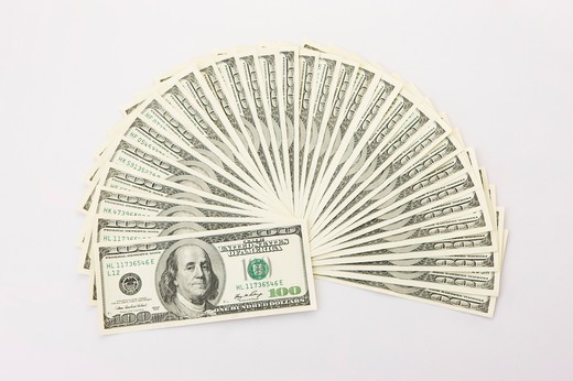 Stock Photo: 1397R-75973 US Hundred Dollar Bill forming a fan shape