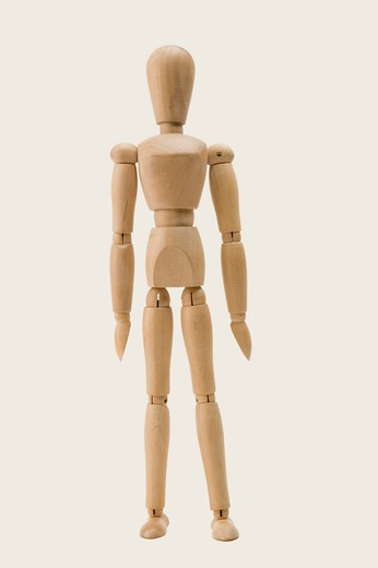 A wooden figurine : Stock Photo