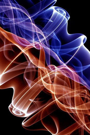 Stock Photo: 1397R-77898 Ethereal drift of blue and brown smoke on black background