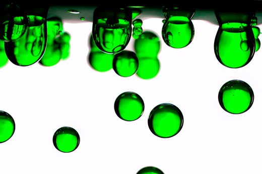 Green water droplets : Stock Photo