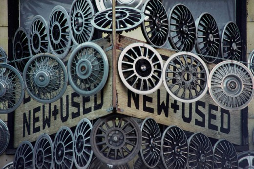 Hubcaps hanging at the front of a store : Stock Photo