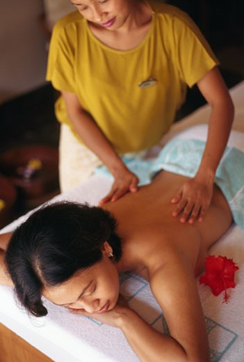 Stock Photo: 1403-129 Woman receiving a back massage from a massage therapist, Bali Hyatt, Sanur, Bali, Indonesia