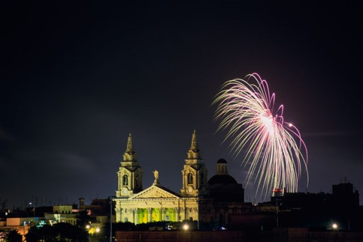 Fire works light up the night sky, St. Publius, Malta : Stock Photo