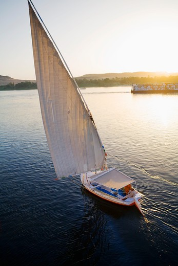 Egypt, Aswan, Felucca  on Nile River at sunset : Stock Photo