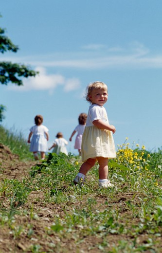Stock Photo: 1406-314 Four girls playing in a field