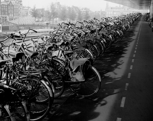 Stock Photo: 1408-624 Bicycles parked in a row, Central Station, Amsterdam, Netherlands