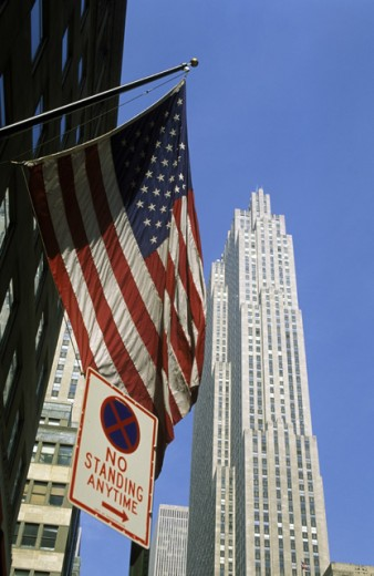 Low angle view of an American flag, Rockefeller Center, Manhattan, New York City, New York, USA : Stock Photo