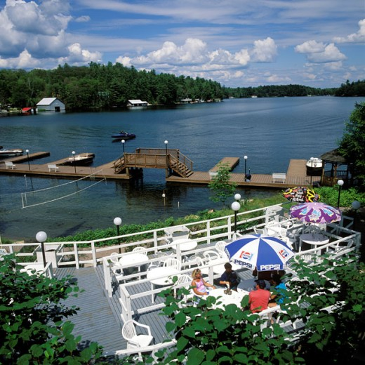High angle view of tourists sitting in a tourist resort, Lake Muskoka, Ontario, Canada : Stock Photo
