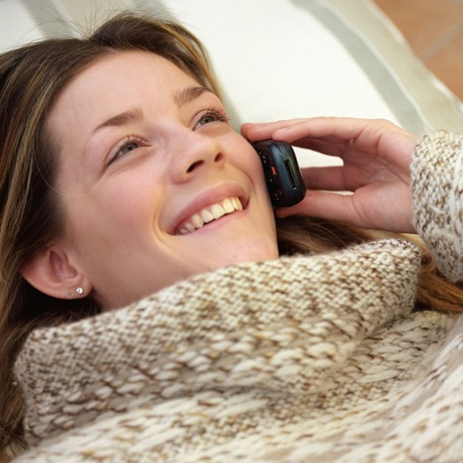 Close-up of a teenage girl talking on a mobile phone : Stock Photo