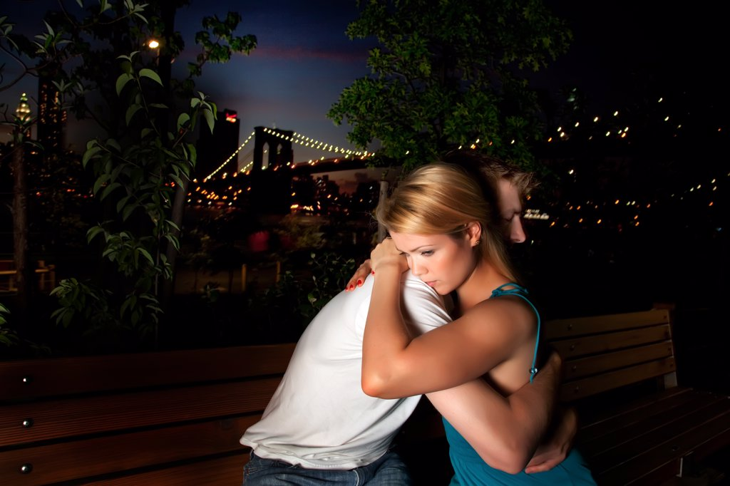 Stock Photo: 1418-662 Young couple embracing each other in a park, New York City, New York State, USA