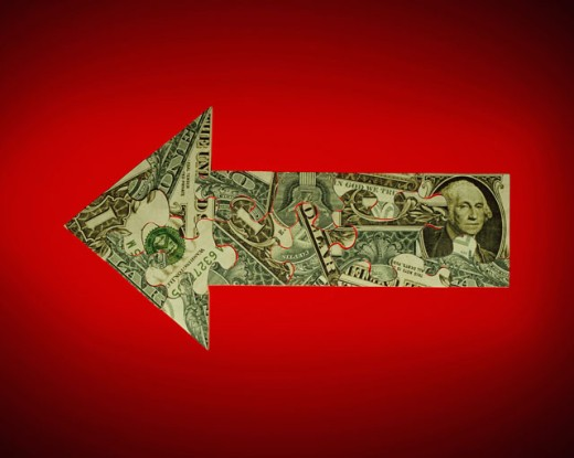 Stock Photo: 1422-319 Close-up of an US dollar bill in the shape of an arrow