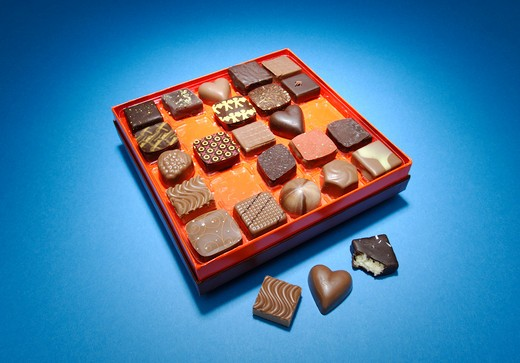 Stock Photo: 1422R-882 Box of designer chocolate pieces in a box on blue background