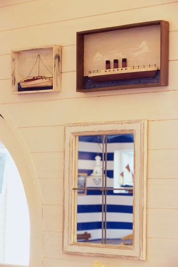 Stock Photo: 1424-114 Model of Boats in wooden frames mounted on a wall, Knokke, Belgium