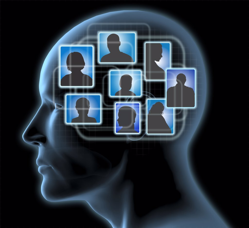 Close-up of a man's head with blue friends profiles inside : Stock Photo