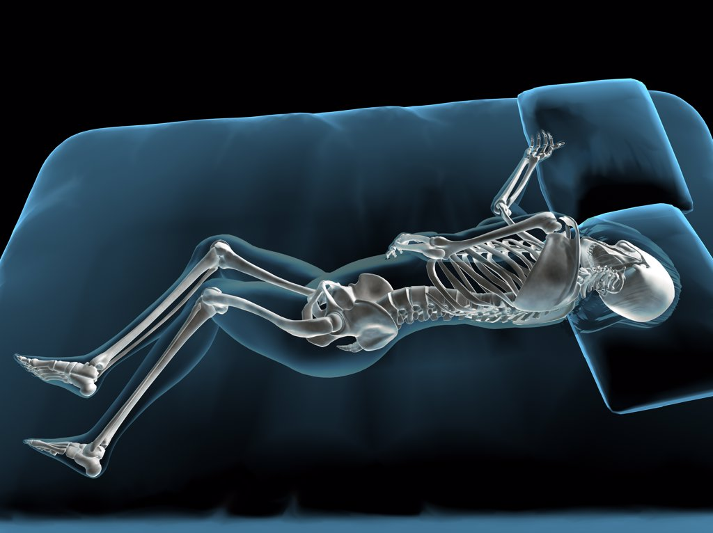 X-ray view of a woman sleeping : Stock Photo