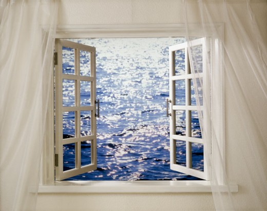 Ripples in the sea viewed through a window : Stock Photo
