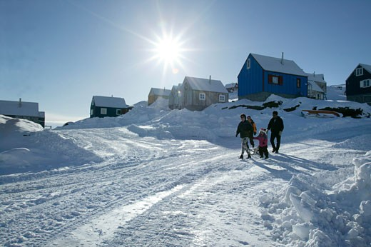 Stock Photo: 143-490 Four people walking on a snow covered road, Ammassalik, Greenland