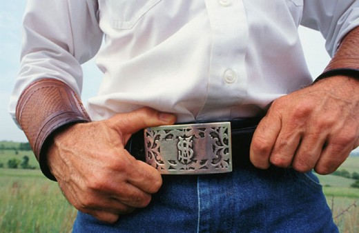 Close up on a silver Cowboy belt buckle featuring a dollar Fort Worth Texas USA : Stock Photo