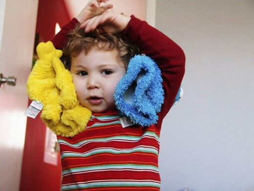 2-year-old boy with stuffed animals : Stock Photo