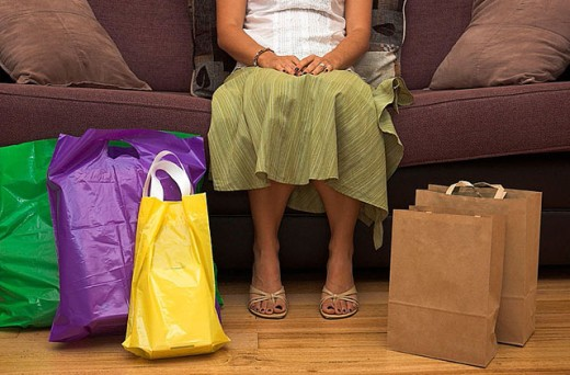 Woman rests after a hard day shopping. : Stock Photo