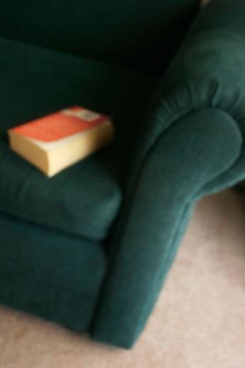 Book on sofa : Stock Photo