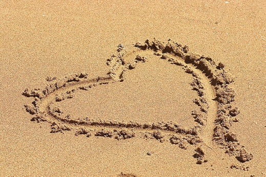 A heart drawn in the sand : Stock Photo