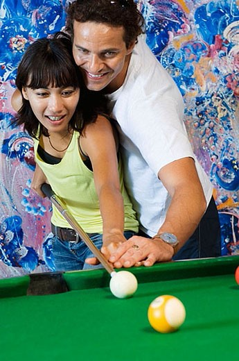 Stock Photo: 1436R-266832 young couple playing billiard