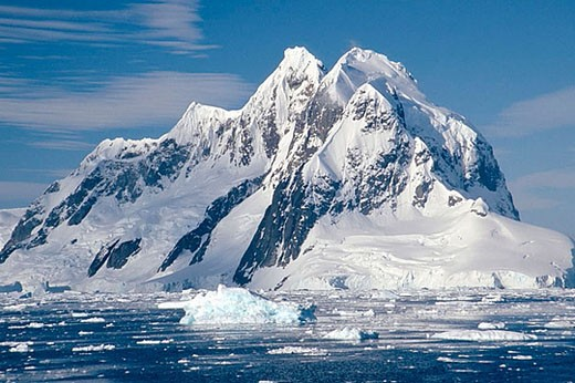 Stock Photo: 1436R-272754 Booth Island. Light summer pack ice. Southern end of Lemaire Channel. Antartic Peninsula